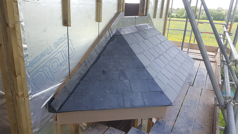 New Build Plain Tile, pan tile and mitred hip slate porch roofs in Bury St Edmunds, Suffolk